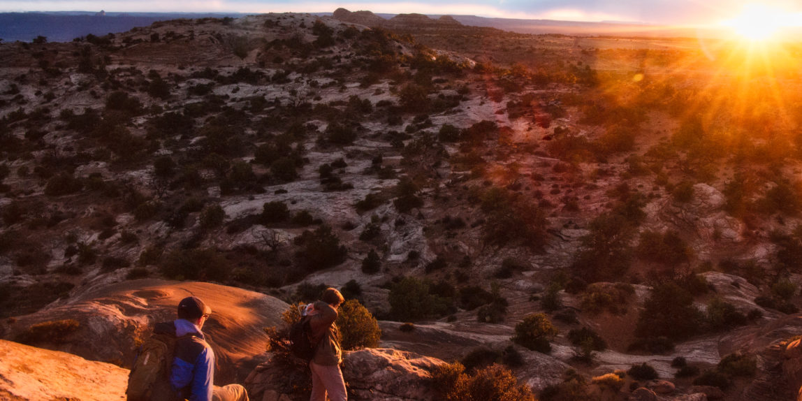 Hiking down cliffs in Utah's Canyonlands National Park